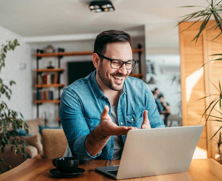 happy guy with laptop